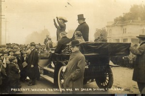 After much research into conflicting accounts it was determined this photo is of President Taft (in top hat) on a presidential visit to Salem on October 12, 1911, being serenaded with America by Salem-area school children on Court Street. WHC 0086.003.0012.013,